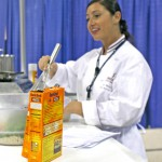 Jackie conducting a brown rice cooking demo as a spokesperson for Uncle Ben's  at ADA's FNCE in Hawaii