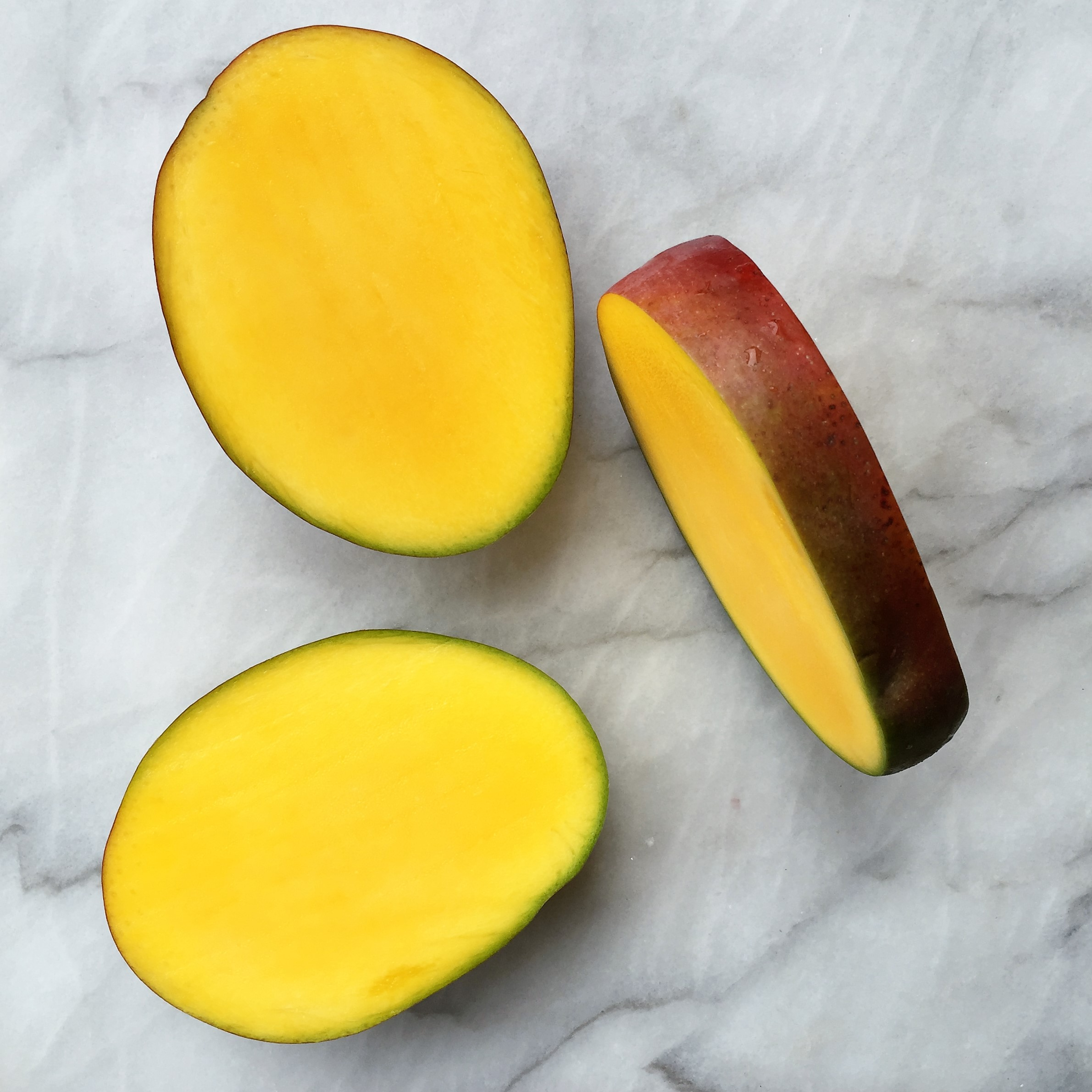 Peel the mango portion containing the seed (on right) and enjoy like a messy popsicle!