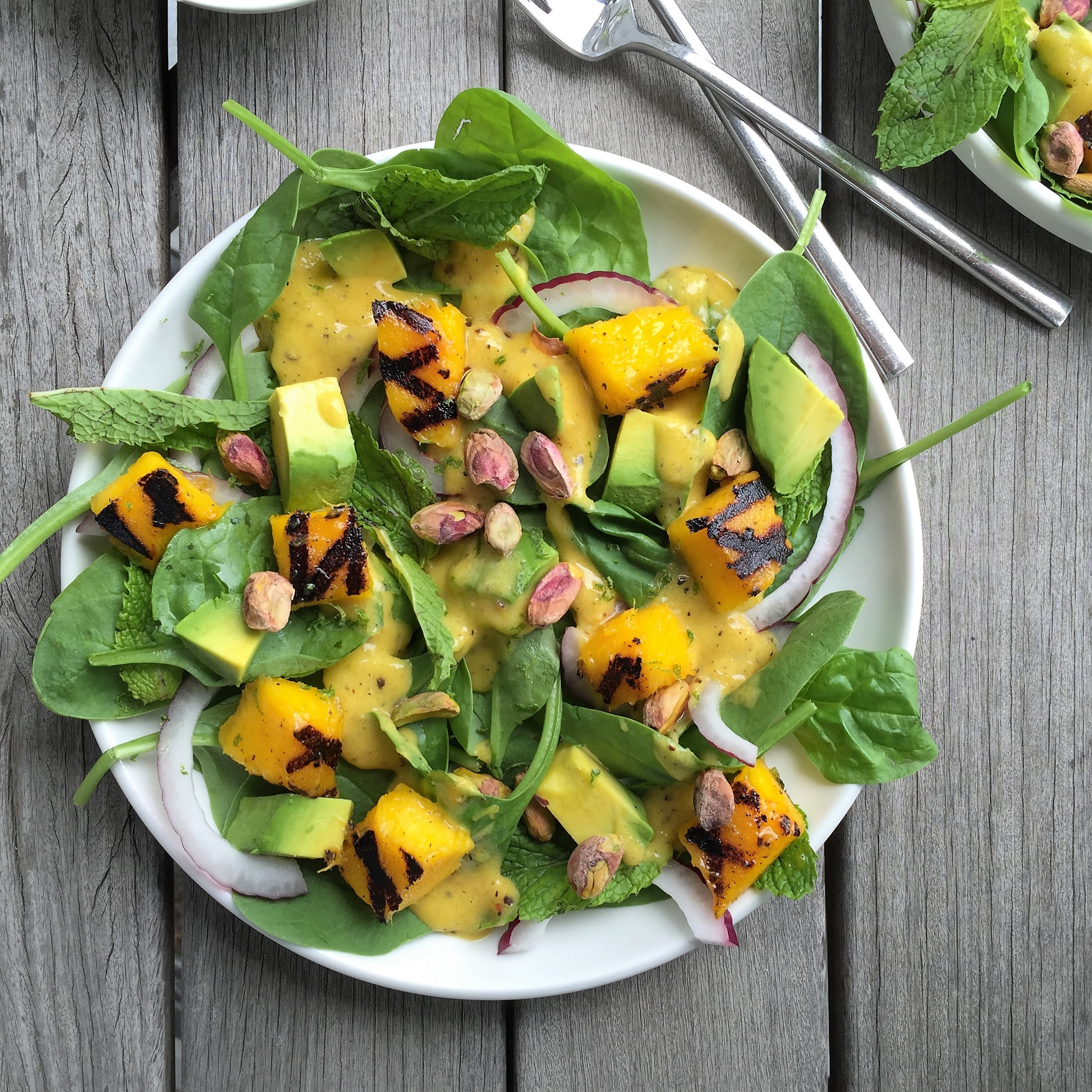 grilled mango salad with avocado & pistachios